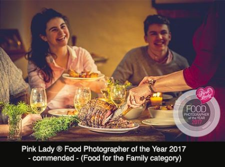 A family enjoying the fun of a traditional roast beef dinner, South West, UK