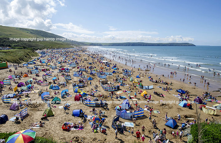 Photo by Guy Harrop. FILE PIC. Woolacombe beach, Devon named best UK beach for a second consecutive year by TripAdvisor users. The 3 mile stretch of golden sand is popular with surfers and beach lovers who pack the destination in the summer months.