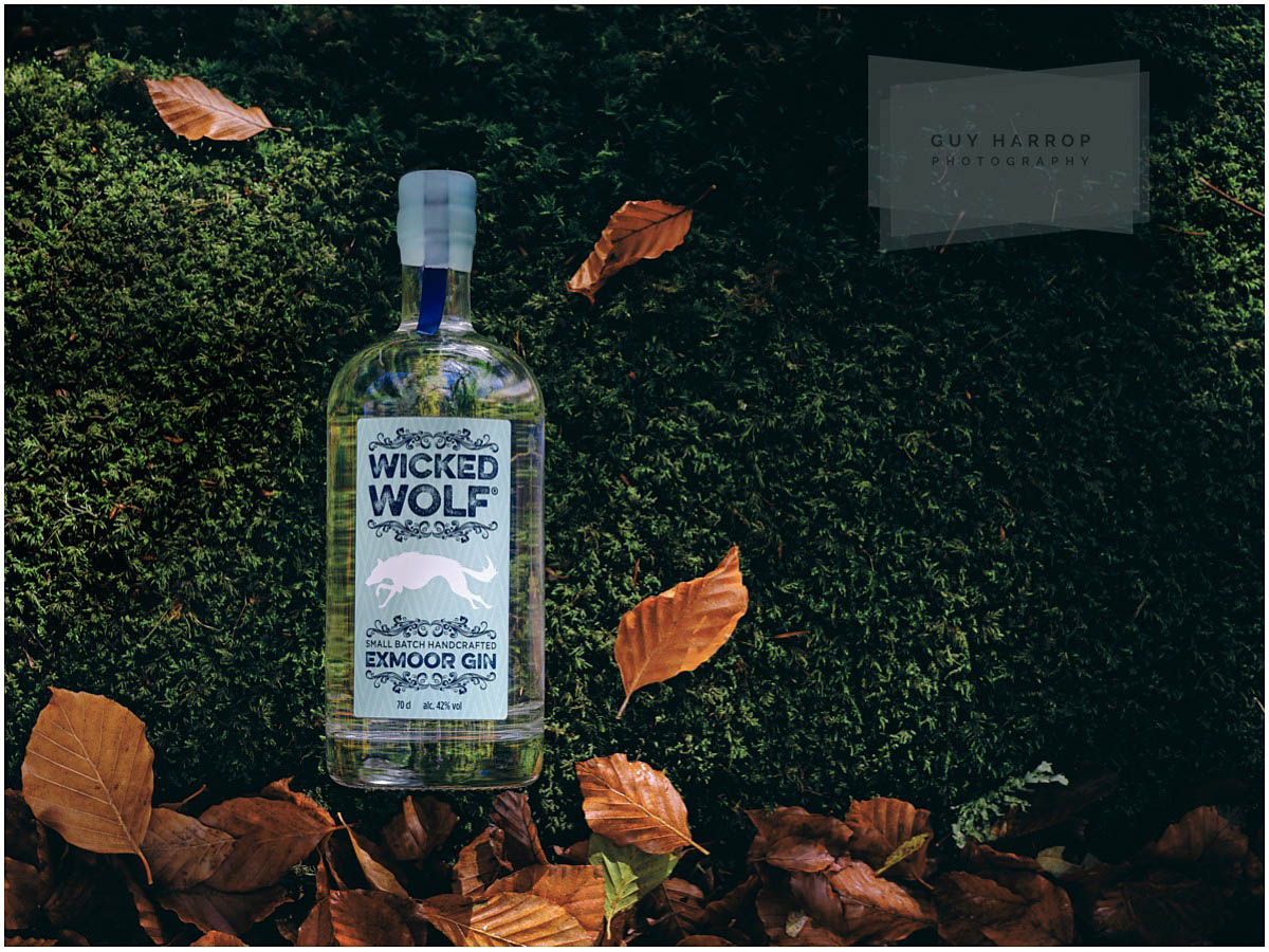 bottle of Wicked Wolf gin surrounded by autumnal leaves © Guy Harrop 2021