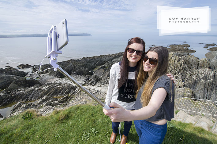 Photo by Guy Harrop. 10/5/16. Holidaymakers April Alder and Anna Volley make the most of the warm weather taking selfie photos of themselves along the coast at Woolacombe in Devon. They are there on holiday all week from Nottingham. image copyright guy harrop info@guyharrop.com 07866 464282