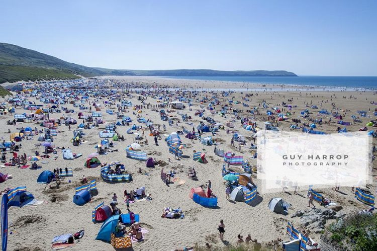 Photo by Guy Harrop. 16/08/16. Thousands of sunbathers enjoy the hot sunshine at Wolacombe beach in Devon where temperatures reached high 20's. image copyright guy harrop info@guyharrop.com 07866 464282
