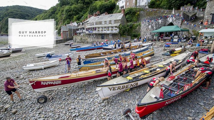 Photo by Guy Harrop. Gig rowers decend on the historical fishing village of Clovelly at the weekend taking part in the 13th gig racing regatta, Devon. The scenic herring fishing village provided a dramatic backdrop as the rowers readied the traditional wooden gigs for the annual races. image copyright guy harrop info@guyharrop.com 07866 464282