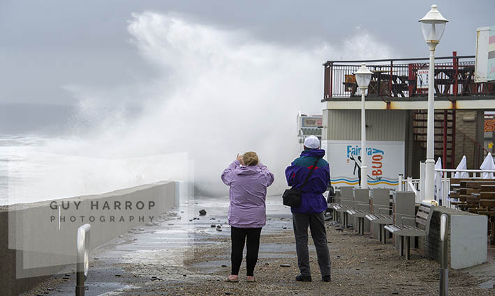 Photo by Guy Harrop. 20/08/16. A couple brave the elements to take photos of stormy waves hitting Westward Ho! in Devon at the weekend as storms hit across the UK . image copyright guy harrop info@guyharrop.com 07866 464282