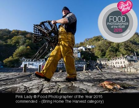 A crab fisherman stacking crab pots before winter, Clovelly, UK  image copyright guy harrop info@guyharrop.com 07866 464282